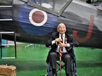 Stanley David, one of two former members of the SOE who attended the exhibition opening, in front of the Museum's newly-acquired Lysander full-size replica.