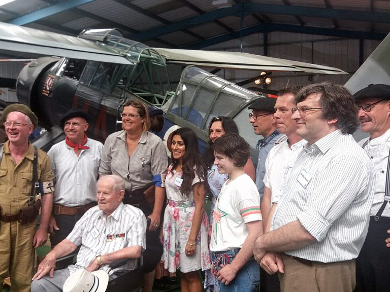 The cast of the BBC TV Series 'Secret Agent: WW2' and SOE reenactors from 'The Baker Street Boys', pose in front of Tangmere's Lysander with former SOE radio operator, Fred Bailey. (Photo: Len Outridge)