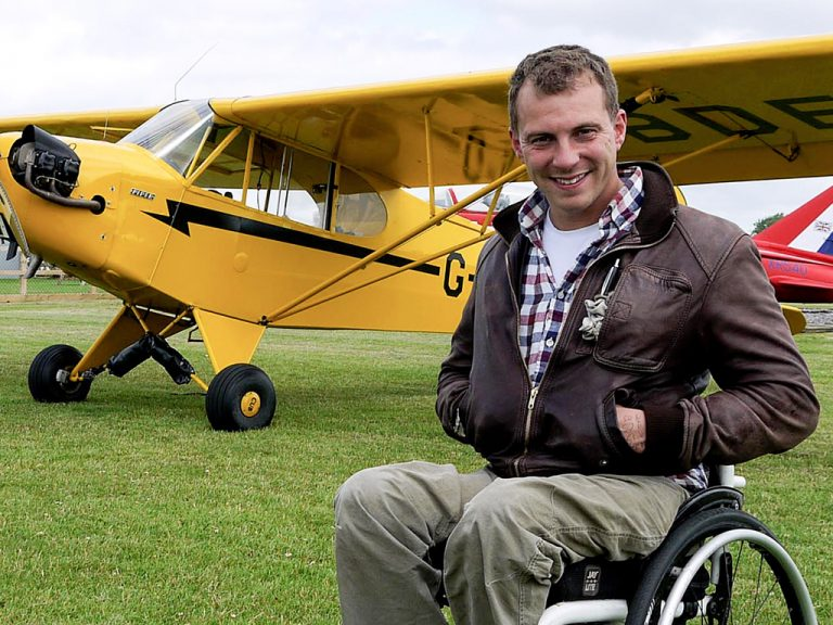 Arthur Williams with the Piper Cub he used in Channel 4's 'Flying Across Britain with Arthur Williams'.