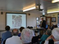 Graham Williams giving a talk on his air race experience in the Museum's Neville Duke Hall.